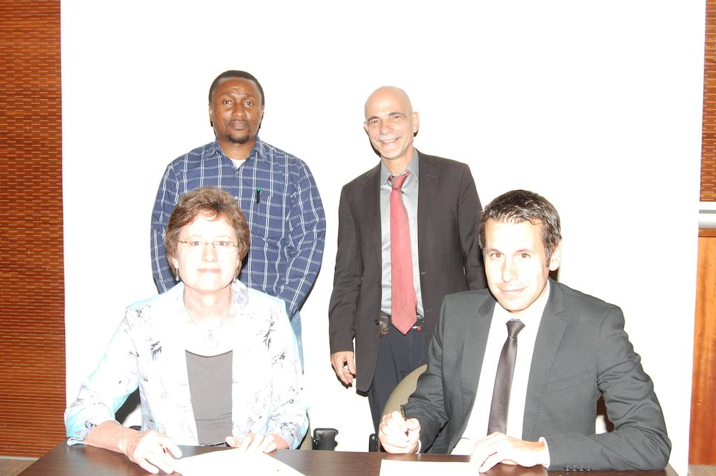 UP and CIRAD staff signing the memorandum