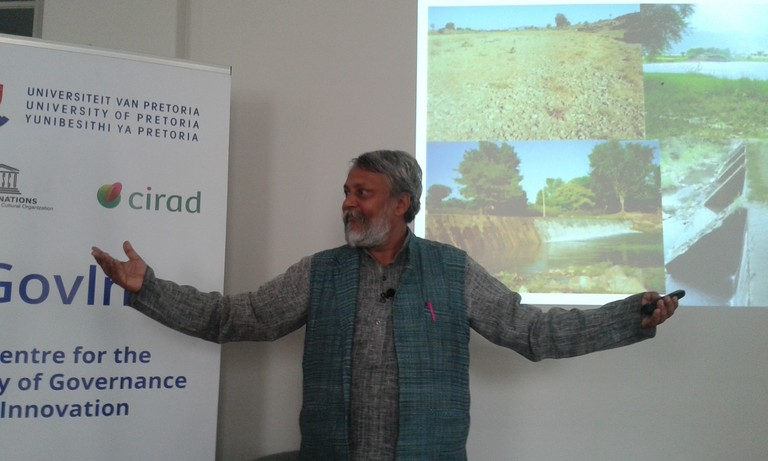 A gesturing Rajendra Singh during his presentation